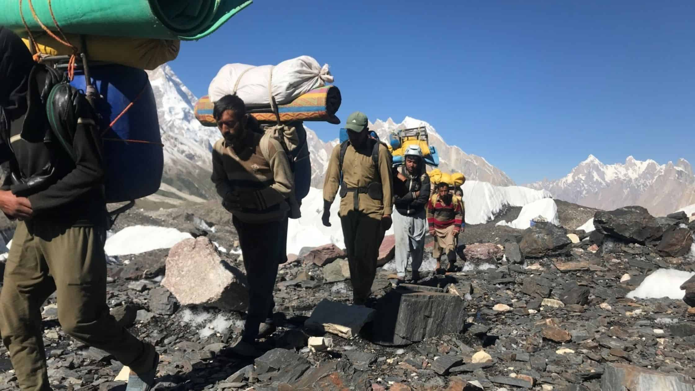 Porters carrying luggage to K2 base camp trek